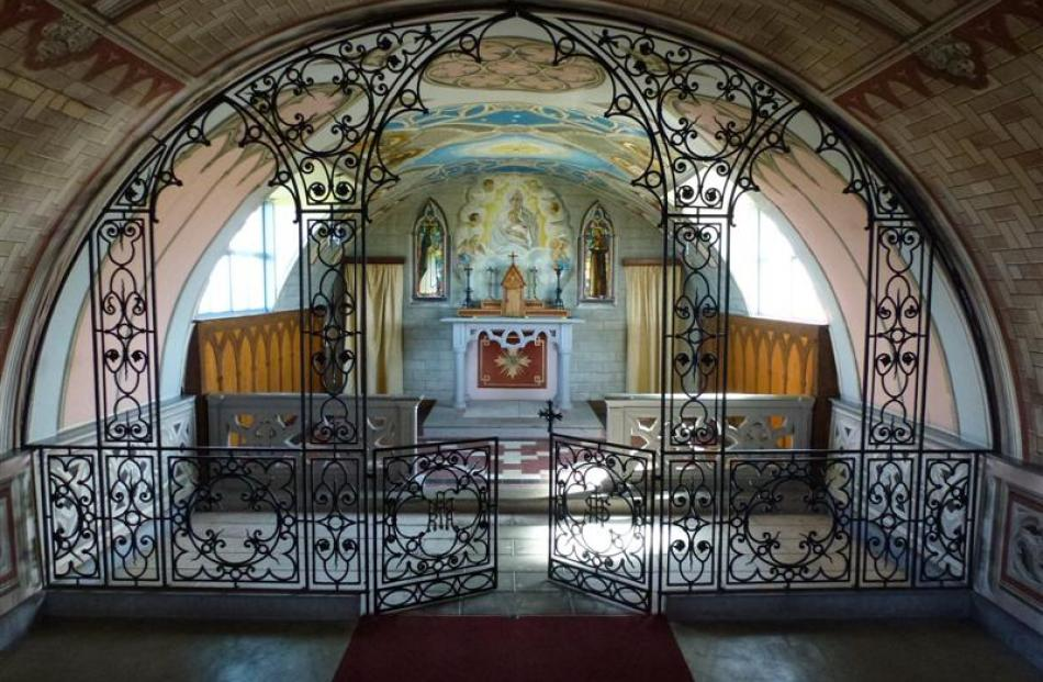 Ornate artwork in the chancel area of the little church.