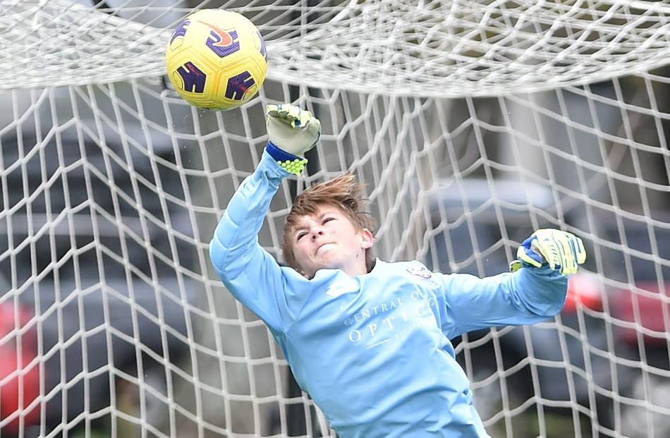 Cromwell and Alexandra goalkeeper Jonathan Jorgensen makes a valiant effort to save a goal in a...