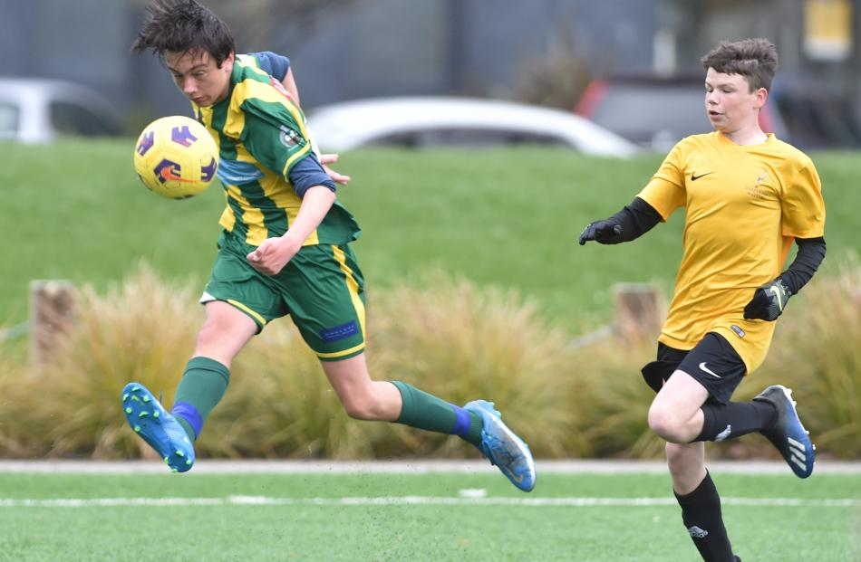 Green Island's Liam Prent (15) shoots from near the sideline as Waitaki's Max Winter (14) chases...
