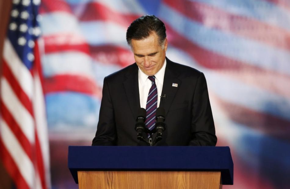 Republican presidential nominee Mitt Romney delivers his concession speech during his election...
