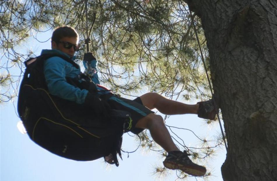 Mr  Letham   abseils down the tree. Photo by James Beech.