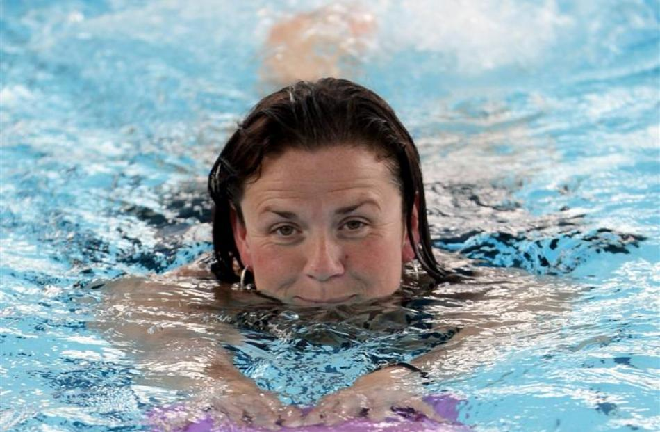 Swimmer Kathy-Jo Dobson uses a flutter-board while putting in a few lengths at the Physio Pool.