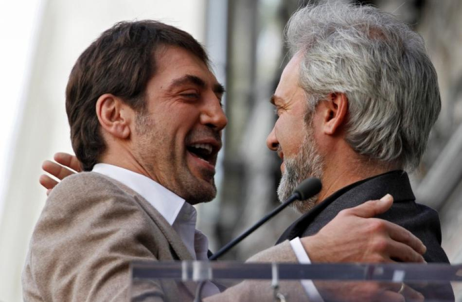 Actor Javier Bardem (L) and director Sam Mendes embrace during a ceremony honouring the actor...