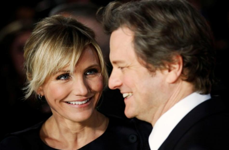 Cast members Cameron Diaz and Colin Firth (R) arrive for the world premiere of the film 'Gambit'...