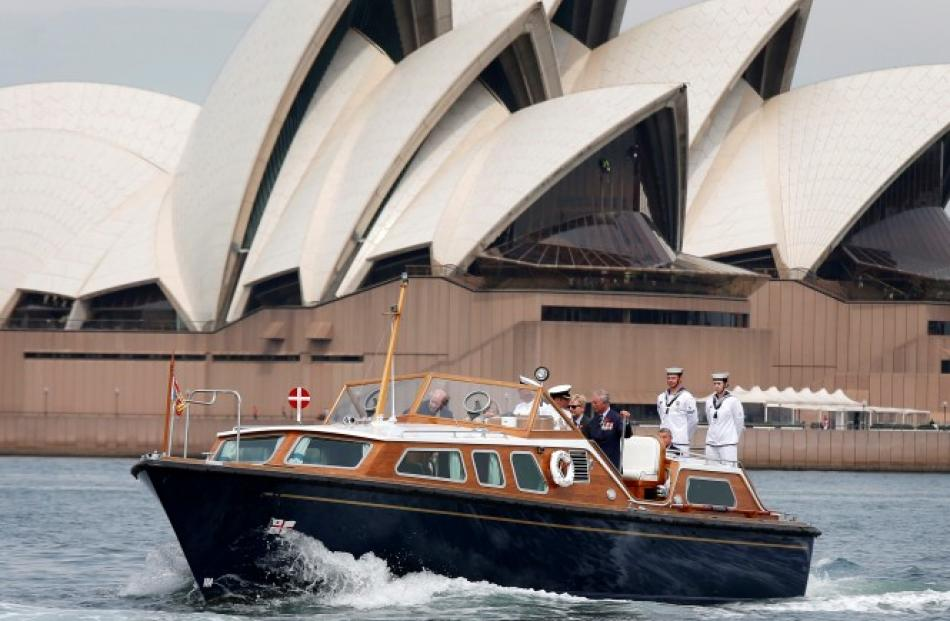 Prince Charles travels on the Admiral's Barge past the Sydney Opera House as he crosses Sydney...