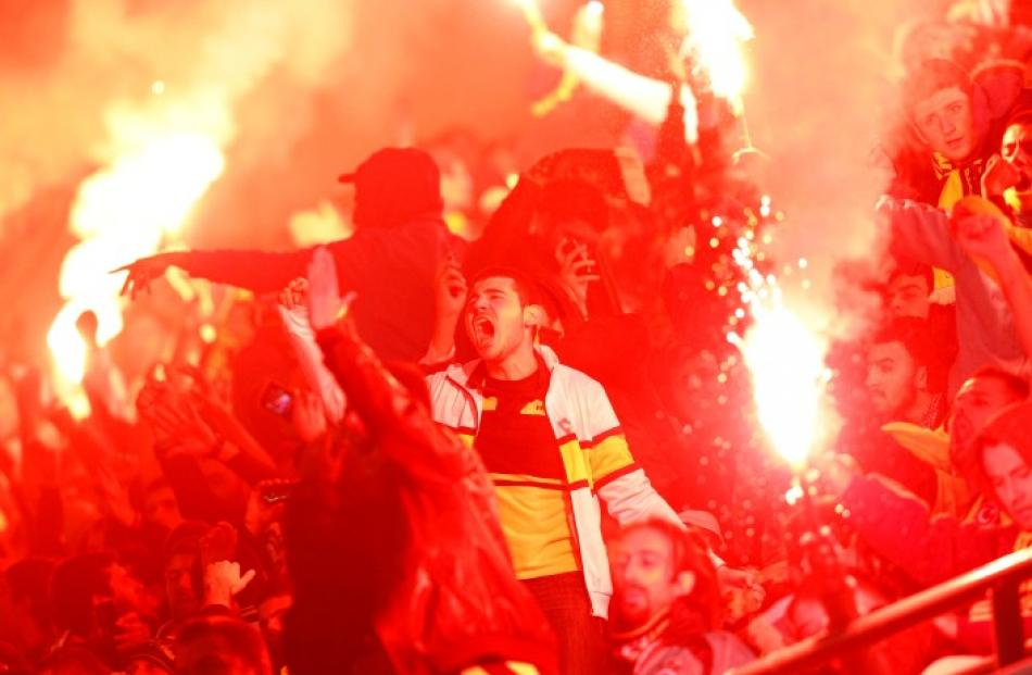 Fenerbahce's supporters react during their Europa League football match against AEL Limassol in...