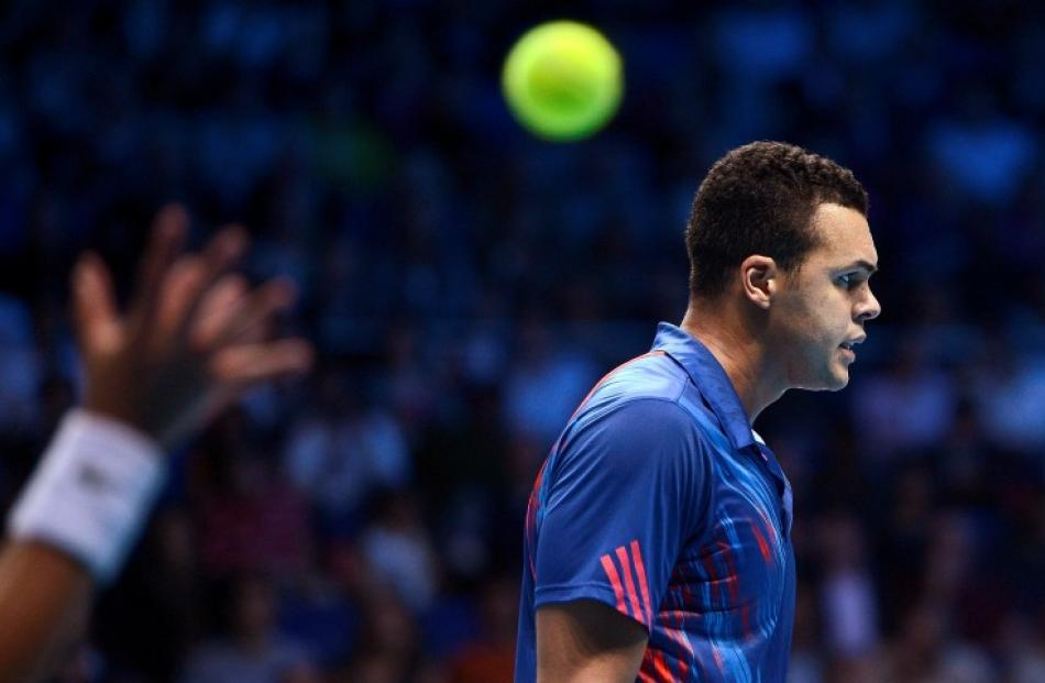 France's Jo-Wilfried Tsonga reacts after losing a point to Czech Republic's Tomas Berdych during...