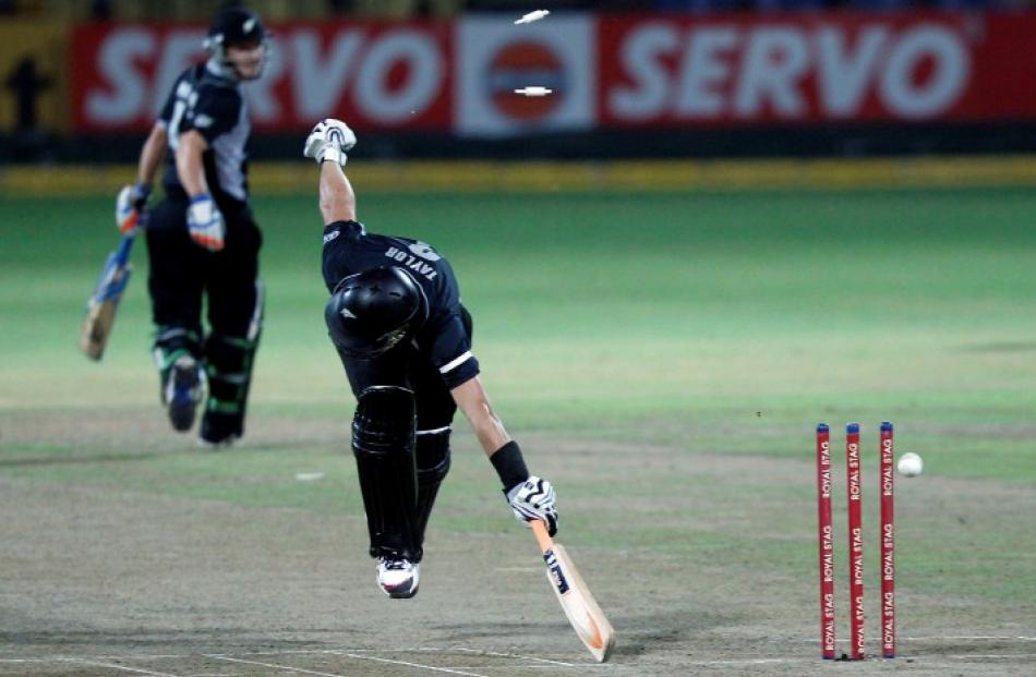 New Zealand captain Ross Taylor is run out by Sri Lanka's Jeevan Mendis during their third One...