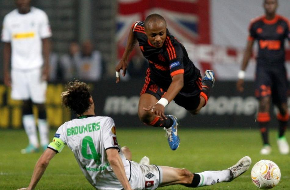 Olympique Marseille's Andre Ayew (R) challenges Borussia Monchengladbach's Roel Brouwers during...