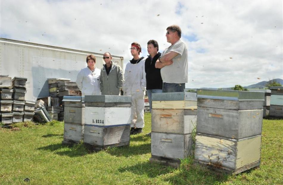 Looking over hives used to breed better Queen bees in Mosgiel are (from left) Betta Bees...