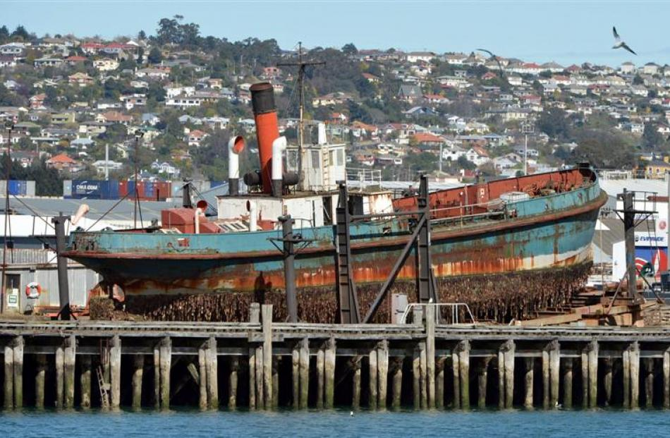 The historic steam dredge, Te Whaka, on the Birch St slip in September before being cut up,...