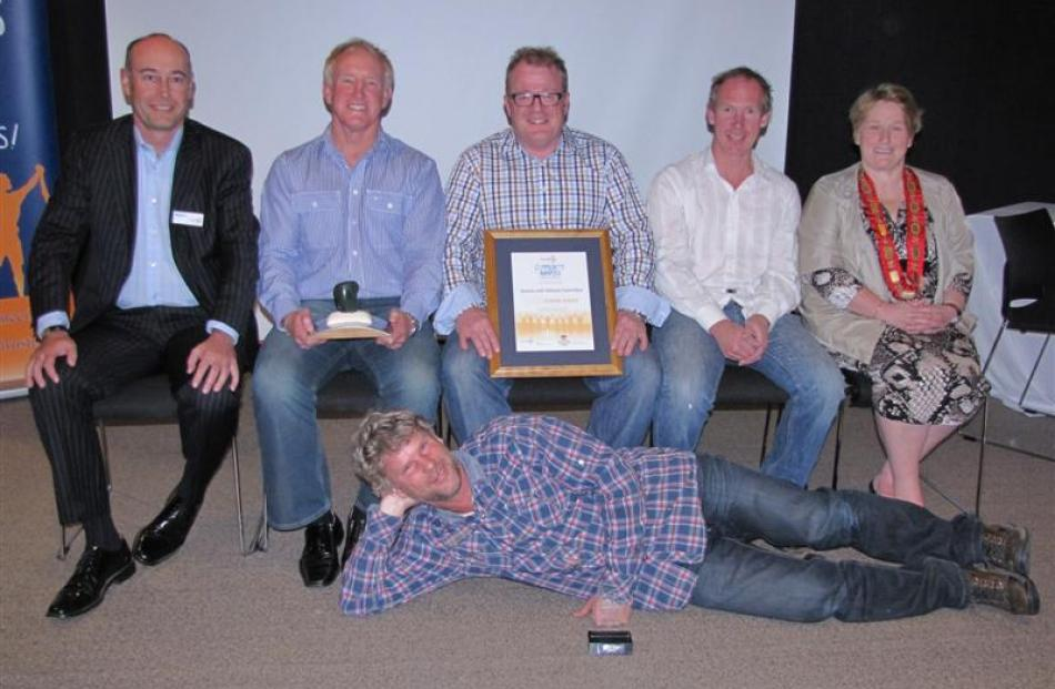 Queenstown's Sevens With Altitude Committee won the supreme award.   Celebrating  are (from left)...