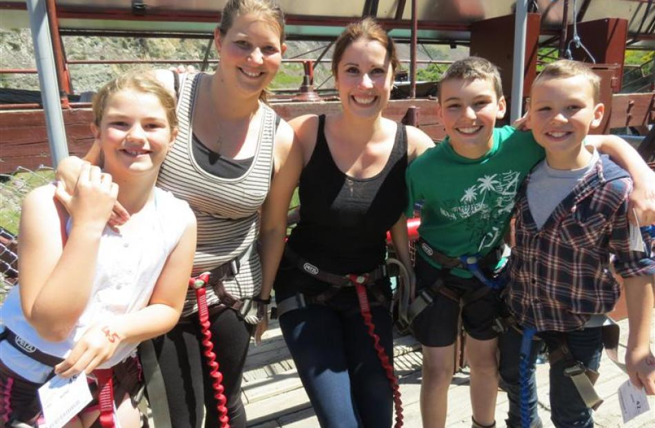 Bungy jumpers (from left) KingsView School pupil Mackenzie Shewan (10), teacher Marlene van...