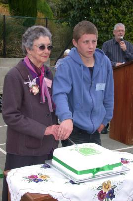 Cutting the cake are the oldest pupil, 97-year-old Bina Mulligan (nee Fallon) of Oamaru, and the...
