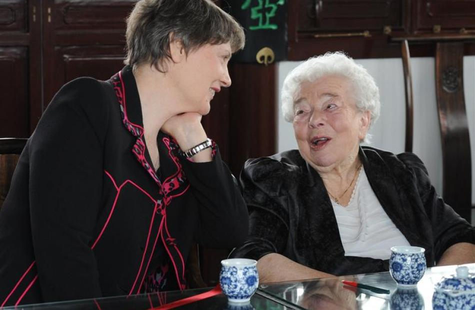 Former prime minister Helen Clark and Dame Dorothy Fraser share a laugh and a green tea at the...