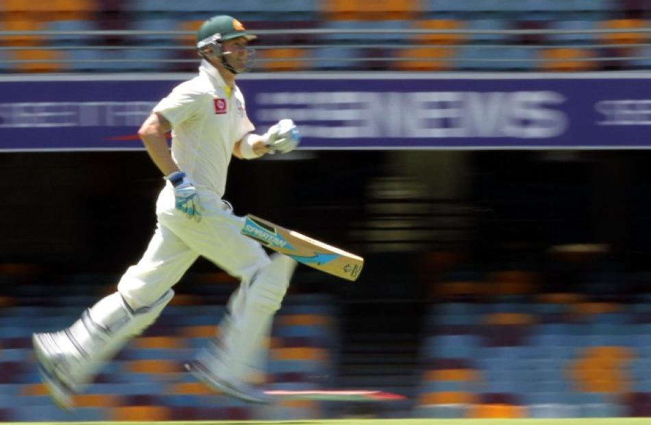 Australia captain Michael Clarke completes a run against South Africa during the first test at...