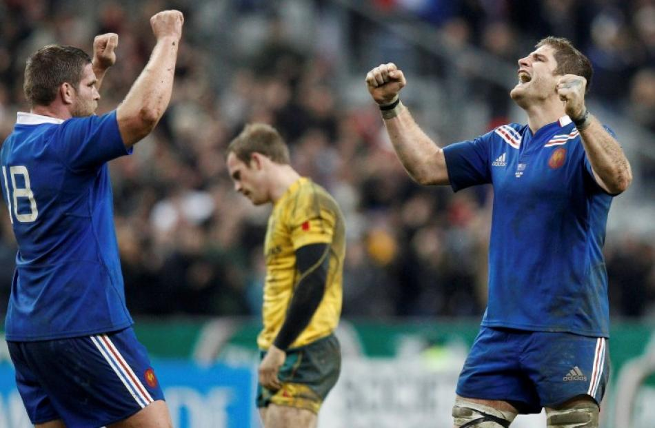 France's Vincent Debaty (L) and Pascal Pape celebrate after beating Australia during their rugby...