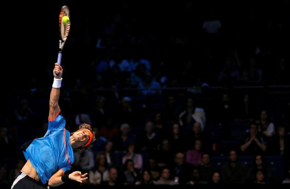 Spain's David Ferrer serves to Serbia's Janko Tipsarevic during their men's singles tennis match...
