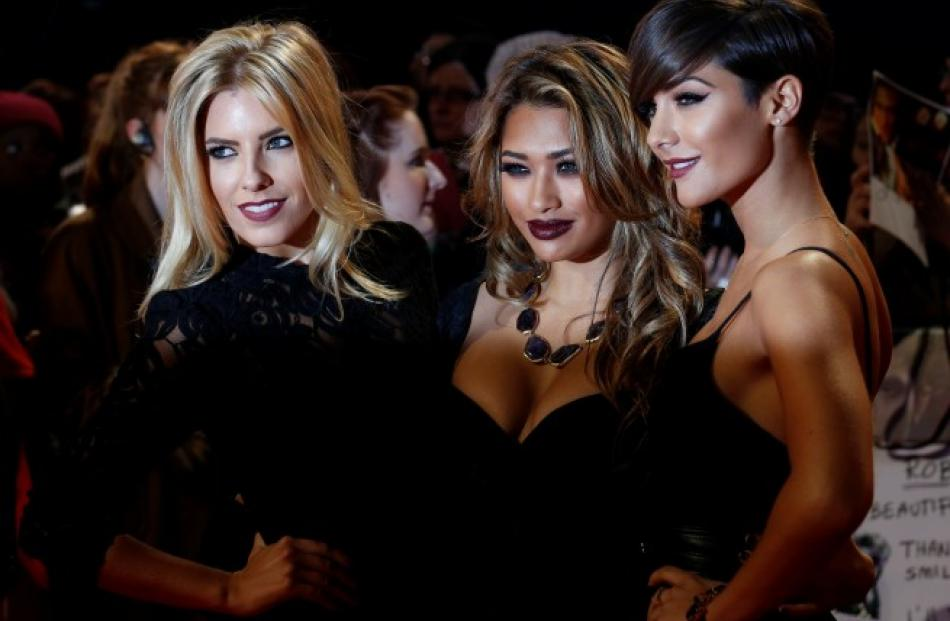 Mollie King (L), Vanessa White (C) and Frankie Sandford of The Saturdays arrive for the European...