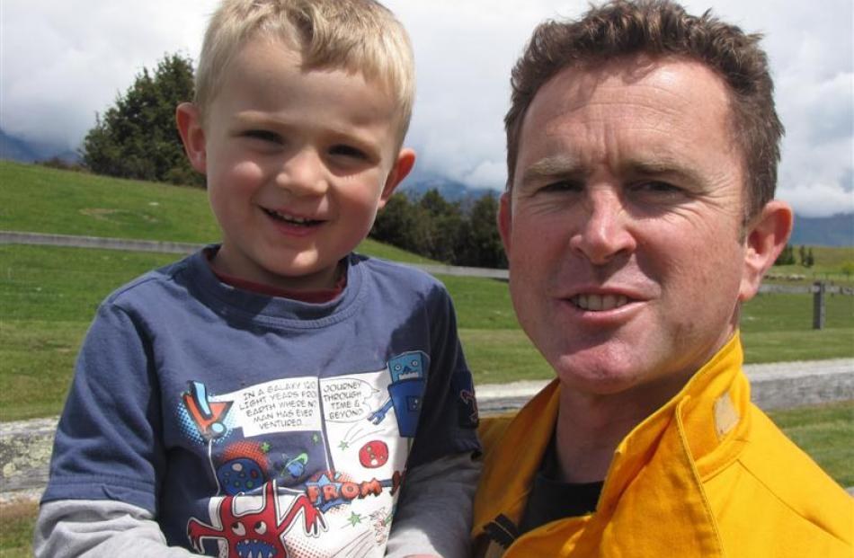 Saxon Cowan (4) with his  father  Jamie, Department of Conservation Wakatipu's rural fire officer.