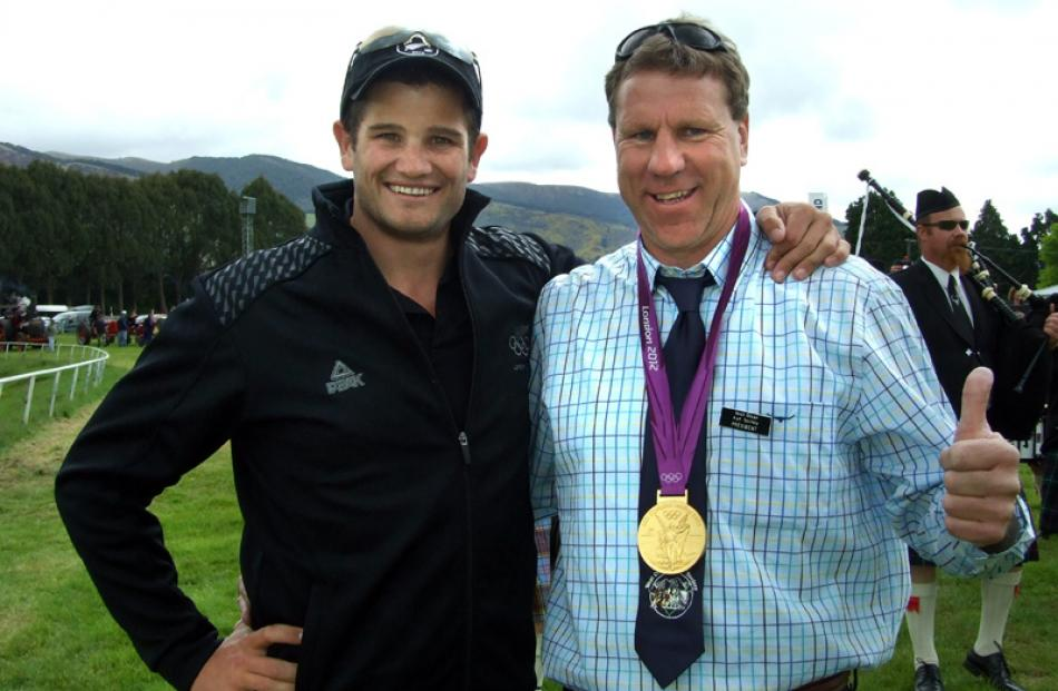 Olympic gold medallist Nathan Cohen lends his bling to West Otago A and P Society president Brian...