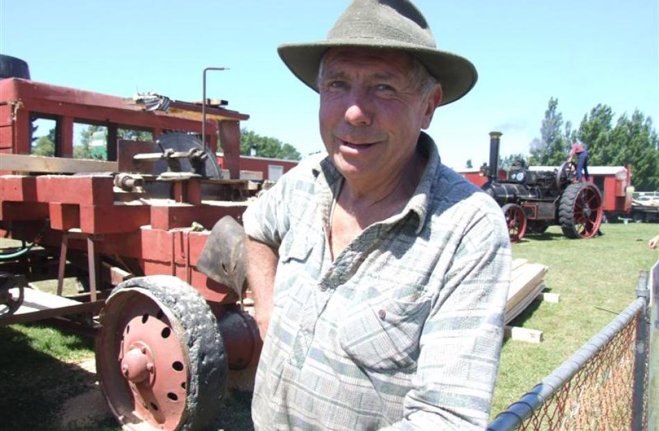 John Hawkins takes a break from a sawmilling demonstration. The Hawkins family's 1909 Burrell...