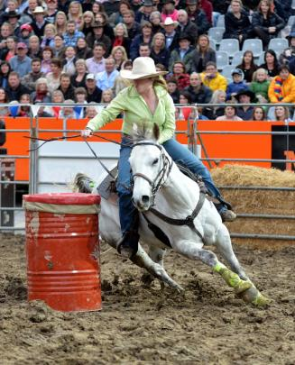 Olivia Ross from Nightcaps and her horse Waylon Jennings round a barrel on the barrel race.