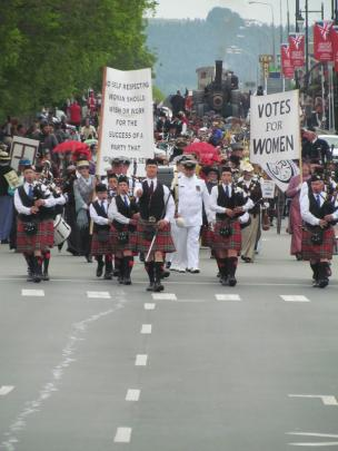 The grand parade marches down Thames St.