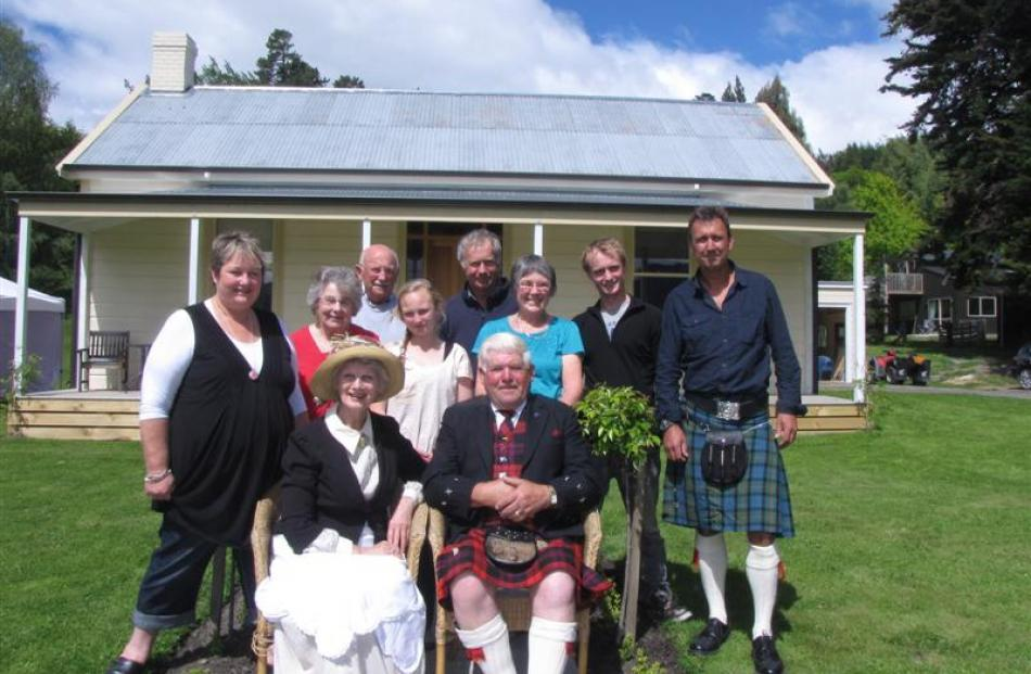 Outside the restored cottage are (front) Isla Trapski, of Hamilton, and Warren Brown, of Te Anau,...
