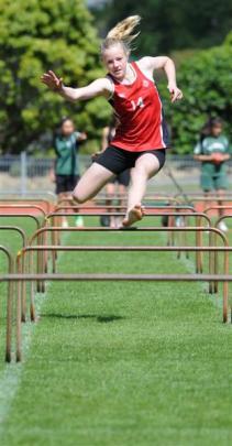 Fairfield's Jordyn Patterson (12) in the hurdles
