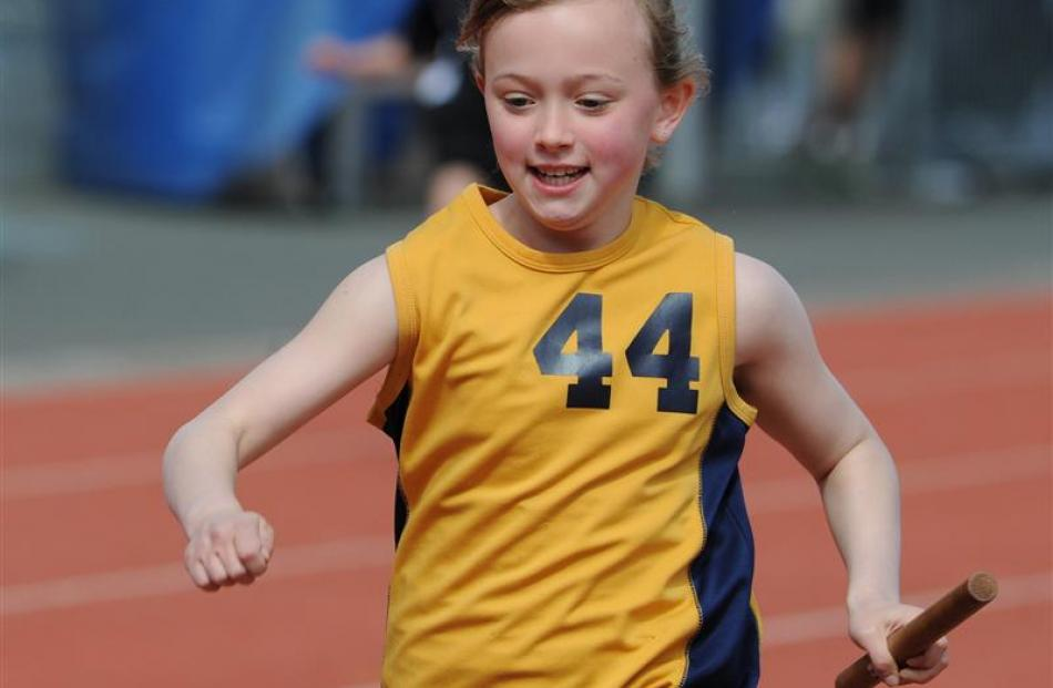 George Street's Zoe McCane (9) carries the baton during a relay