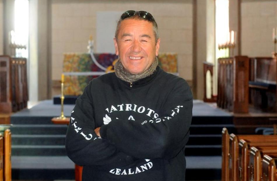 White ribbon rider Richard Bradley stopped in Dunedin yesterday to encourage men to end violence...