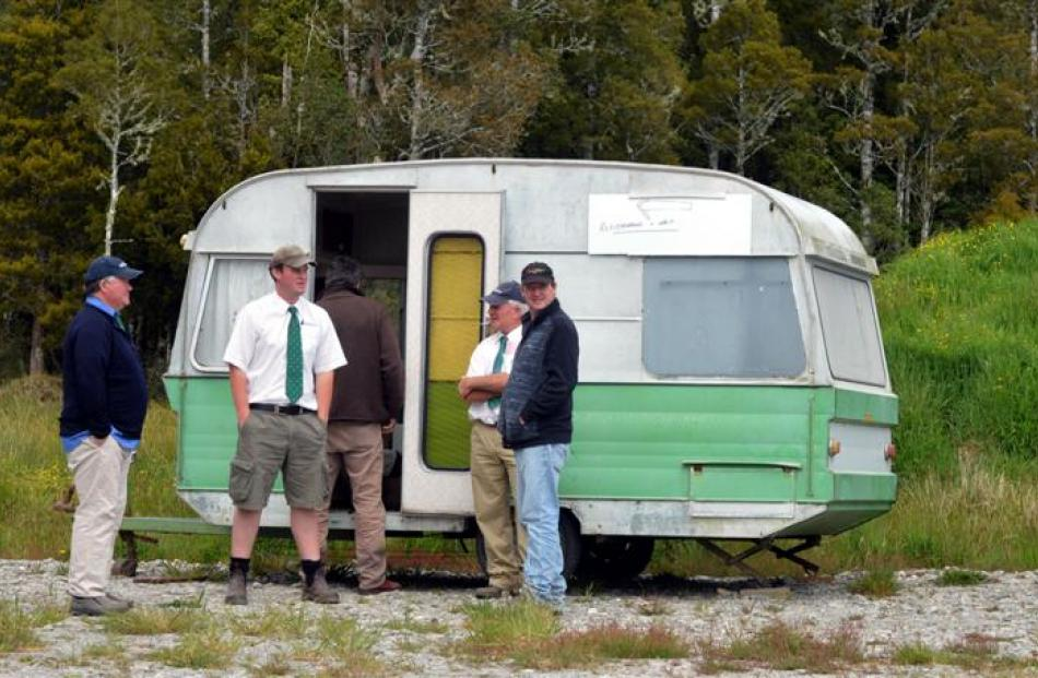 An old caravan is the venue for registrations by potential buyers.