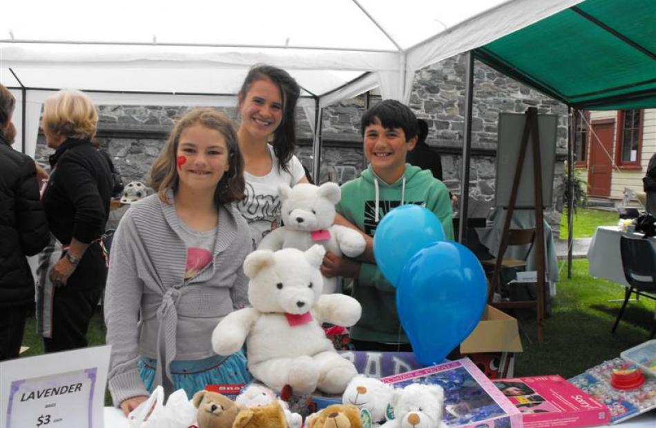In the children's corner selling teddy bears  are  Mackenzie Shewan (10), Gracyn Liscom (12) and...