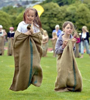 Kendall Garrett (5) (left) and Aria Monks (7) bounce their way to the line in the girls sack race.