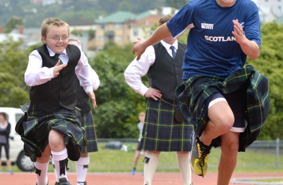 Tykler Morris-Hill (10) and Hugh James (14) race away in the Kilties Dash.