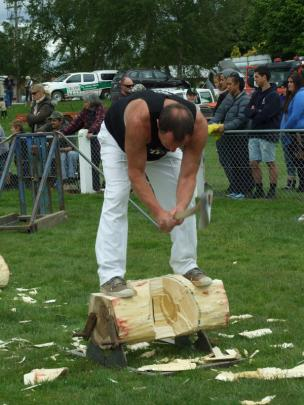 Brian Gutsell, of Gore, competes in the woodchopping section.