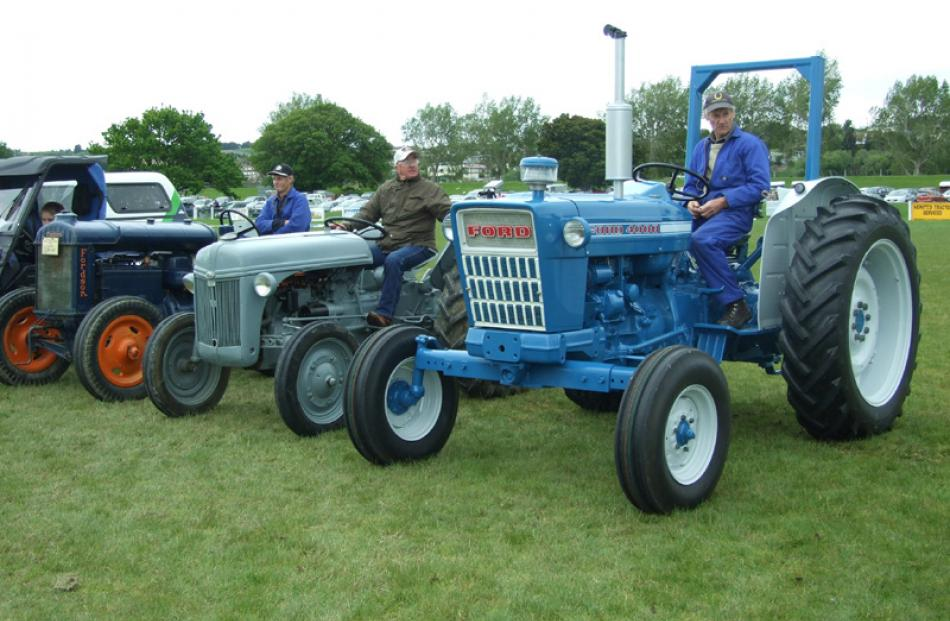 From left: John Watt, Bob Stevenson, and Neville King, with their vintage tractors.