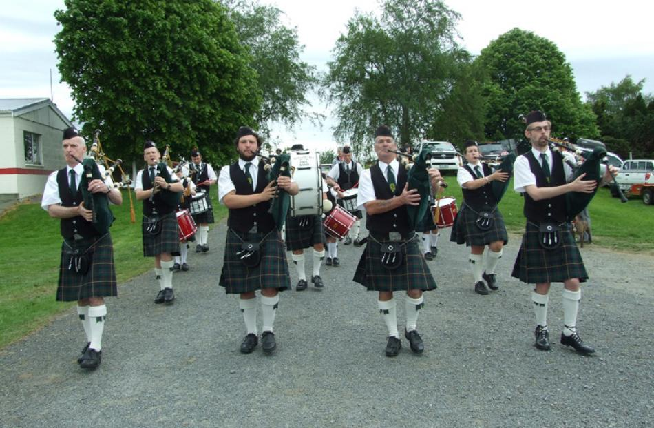 The Balclutha Pipe Band prepares for the grand parade.