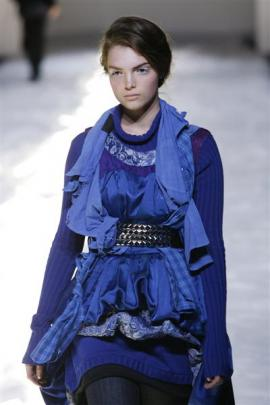 A model wears the same outfit at  Fashion Week, in Auckland in September 2007. Photo from NZ Herald.