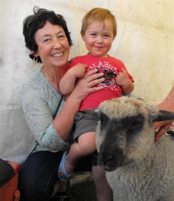 Karen Anderson with grandson Sam Stewart (2) and Sooty the lamb.