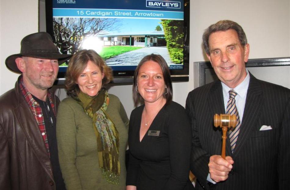 Jeff Dickie, left, and his wife Liz, of Dunedin, with Bayleys Queenstown saleswoman Katharine...
