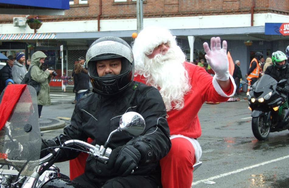 Santa hitches a ride with the Big River Bikers.