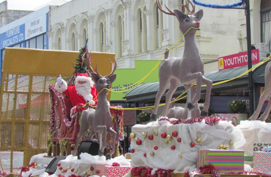 Oamaru's Santa parade passes down Thames St on Sunday.