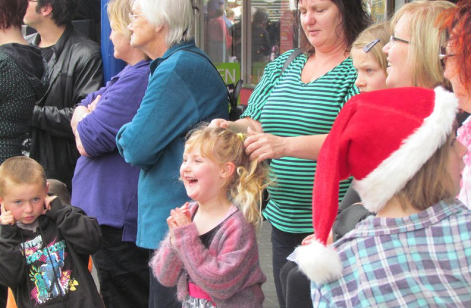 A child at the Oamaru Santa Parade waits eagerly for a glimpse of Santa.