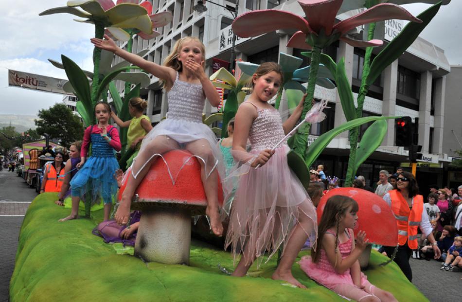 Christmas fairies Mackenzie Barrett (6) blows kisses to the crowd, Ella Monkhouse (9).