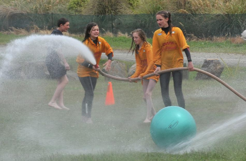 Trainee lifeguards Amanda Muldrew (12), Lydia Taylor-Beecroft (11) and Ola Szukiel-Deans (13) try...