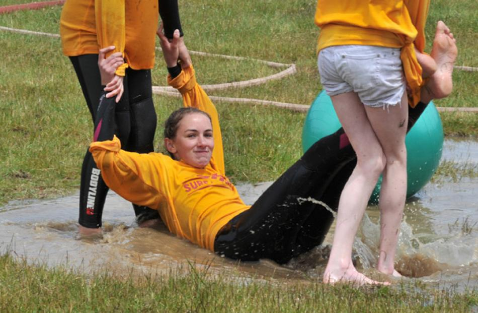 Trainee lifeguard Ola Szukiel-Deans (13) is dragged into a puddle by fellow trainees Amara...