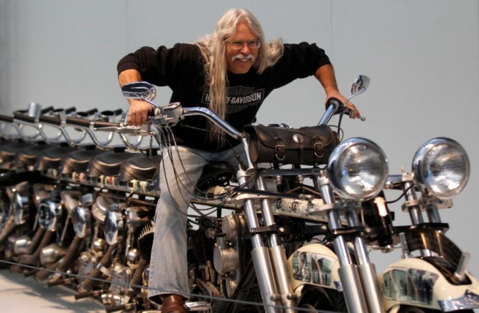 Steve 'Doc' Hopkins poses on his 10-seat Timeline Motorcycle during a press presentation before...