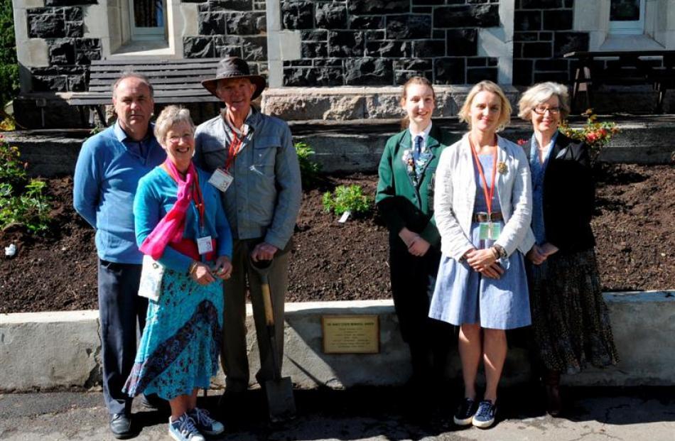 In front of the Nancy Steen Memorial Garden at Columba College are (from left) garden instigator...